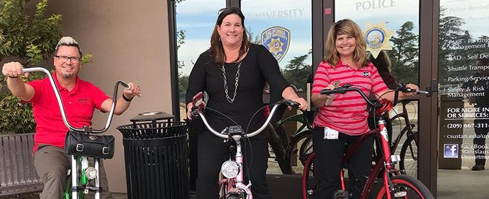 Monica, Michael, and Dawn on their bikes