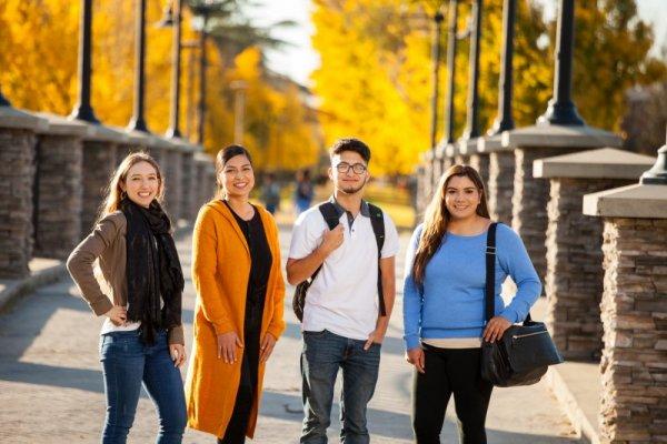 student posing on bridge autumn